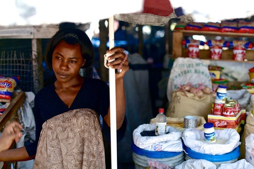 Poverty, Inc._1 ©Mark Waters (Haiti. Enersa Market Woman)