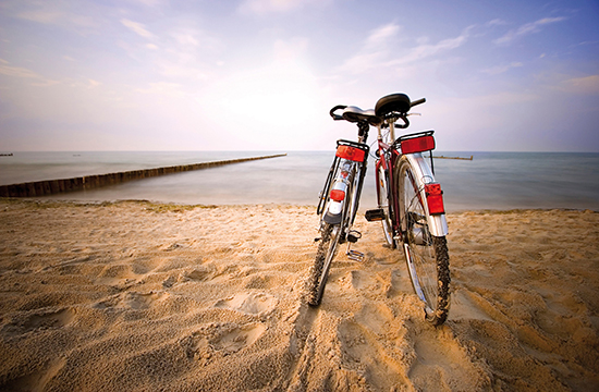 two bicycles at the beach