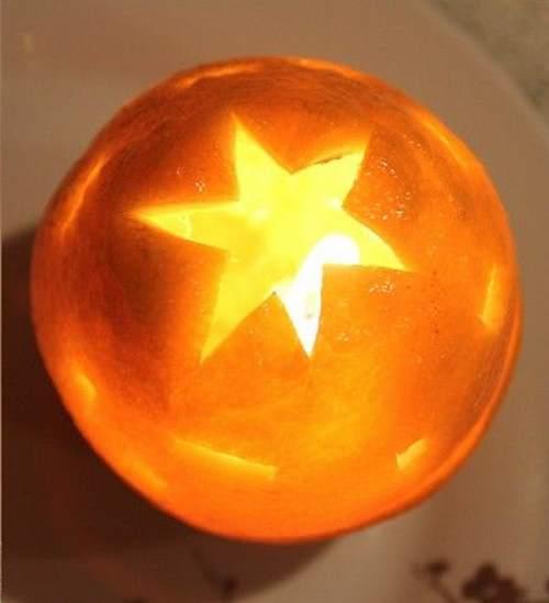 tavola di natale: candele con le arance